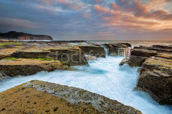 Sunrise  from the eroded rocky channel at North Narrabeen Stock photo © lovleah