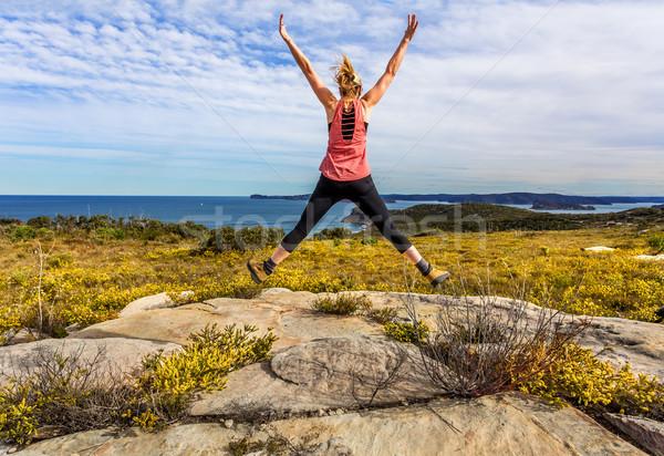 весны женщину прыжки Полевые цветы цветения Сток-фото © lovleah
