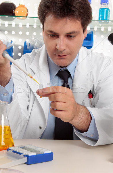 Scientist using pipette in lab Stock photo © lovleah