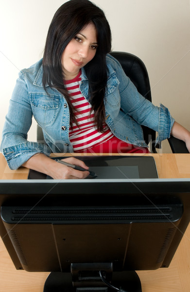 Woman at desk working with a graphic tablet Stock photo © lovleah