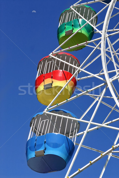 Stock photo: Vivid Ferris Wheel and Moon