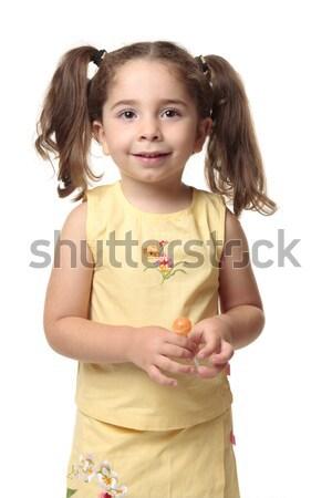 Félénk kisgyerek kislány mosolyog lány citromsárga Stock fotó © lovleah