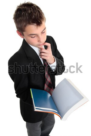 Student pindering thinking with open text book Stock photo © lovleah