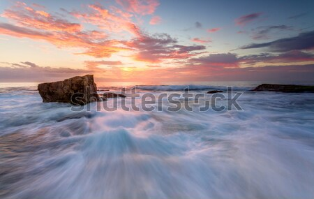 Sunrise north Turrimetta rockshelf flows Stock photo © lovleah