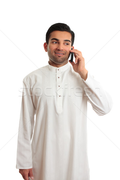 Arab ethnic businessman talking cellphone Stock photo © lovleah