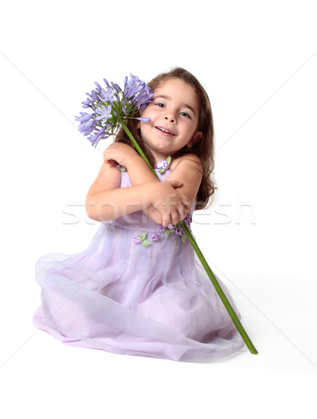 Beautiful smiling girl with pretty flower Stock photo © lovleah
