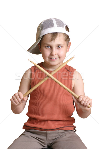 Boy with wooden drumsticks crossed. Stock photo © lovleah