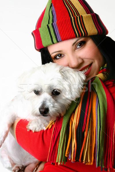Beautiful woman holding a pet dog Stock photo © lovleah