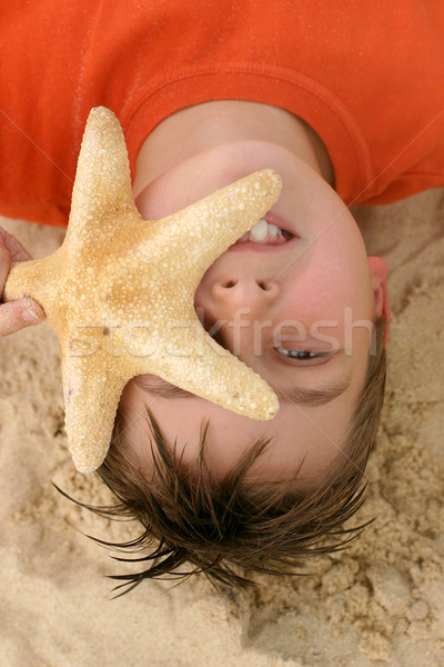 Child with a large starfish Stock photo © lovleah