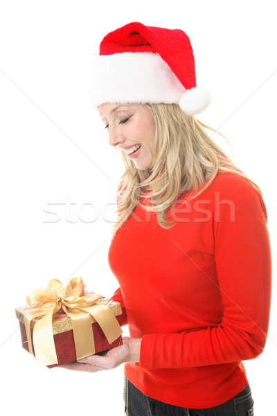 Smiling woman holding a Christmas gift Stock photo © lovleah