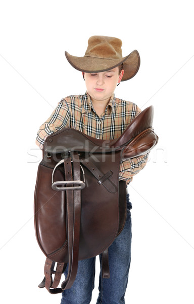 Rural boy holding a saddle Stock photo © lovleah