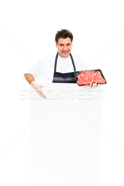 Butcher with advertising sign Stock photo © lovleah