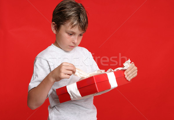 Child opening a present Stock photo © lovleah