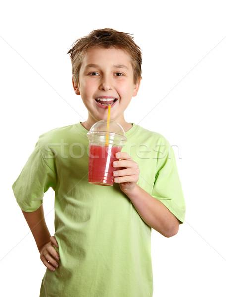 Smiling boy holding a fresh berry fruit juice Stock photo © lovleah