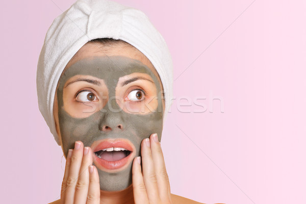 Female in bauty mask with surprised expression Stock photo © lovleah