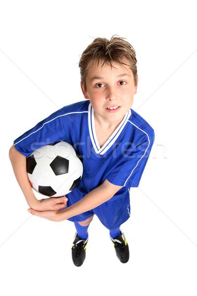 Garçon ballon football uniforme blanche Photo stock © lovleah