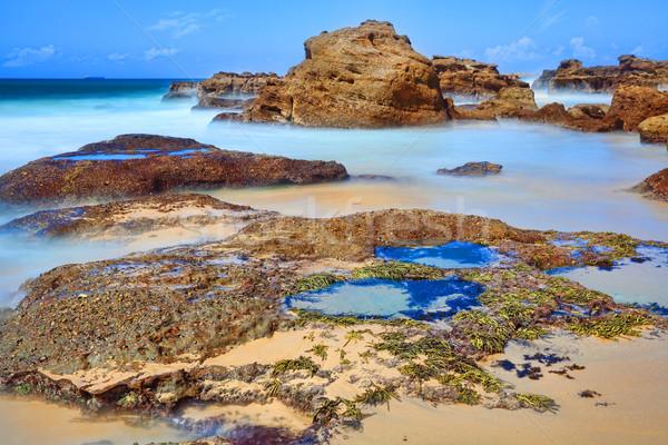 La exposición a largo rocas rock bajo marea movimiento Foto stock © lovleah