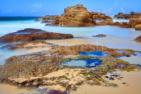 Long exposure rocks and rock pools at low tide Stock photo © lovleah