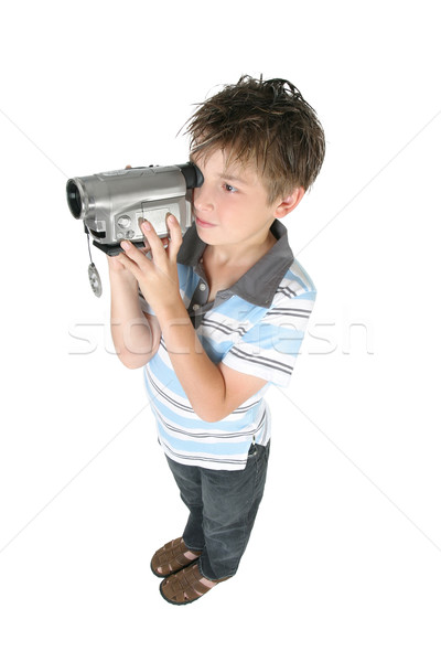 Standing boy using a digital video camera Stock photo © lovleah