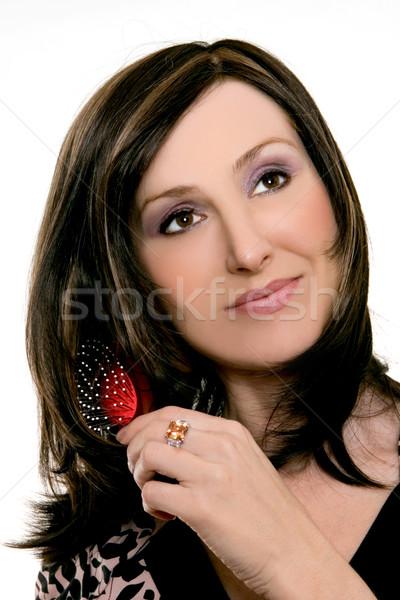 Woman brushing her hair Stock photo © lovleah