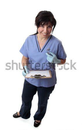 Nurse with medical chart Stock photo © lovleah