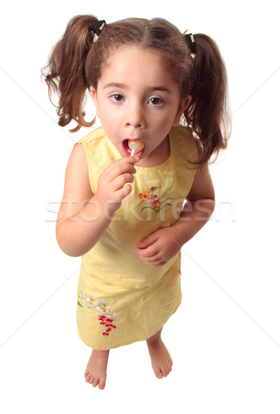 Pretty girl eating a lollipop candy Stock photo © lovleah