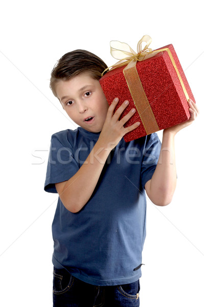 Child shaking a wrapped present Stock photo © lovleah