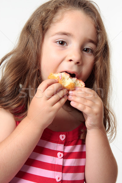 Child eating junk food donut. Stock photo © lovleah