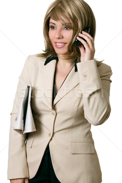 Businesswoman on phone with newspaper under arm Stock photo © lovleah