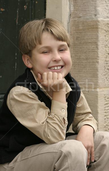 Smiling boy sitting on doorstep Stock photo © lovleah