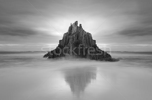 Moody skies over Pyramid rock sea stack Stock photo © lovleah