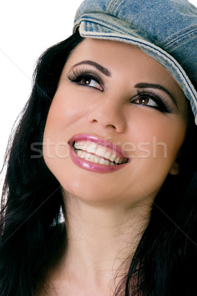 Smiling Female with denim hat looking up Stock photo © lovleah