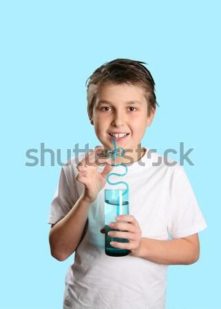 Fiú üveg víz tart zsonglőr ital Stock fotó © lovleah