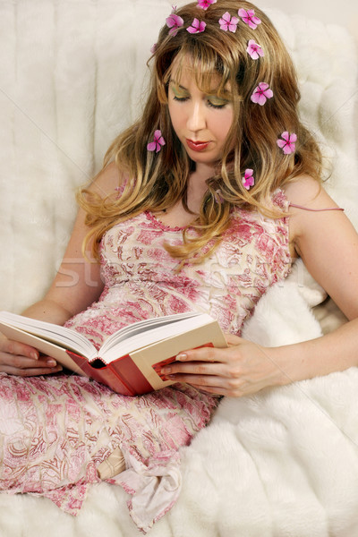 Beautiful woman reading a book. Stock photo © lovleah