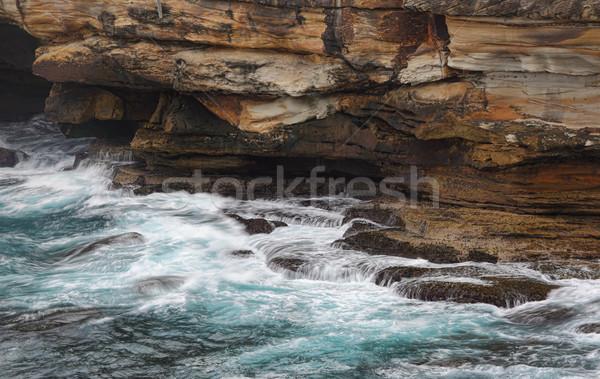 Ocean flows into sea caves Stock photo © lovleah