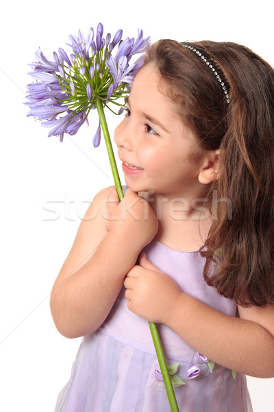 Pretty girl holding a beautiful flower Stock photo © lovleah