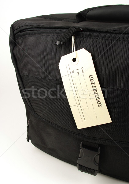 lost property tag and black bag Stock photo © luapvision