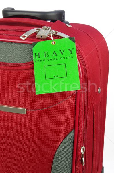Kırmızı seyahat çanta yeşil etiket uyarı Stok fotoğraf © luapvision