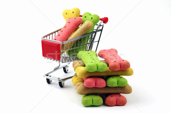 stack of dog biscuits and shopping cart Stock photo © luapvision