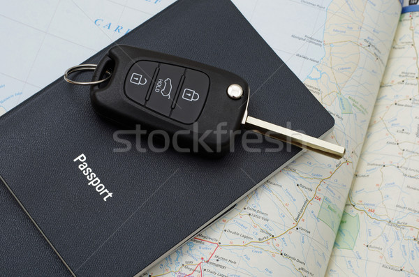 car key on blue passport   Stock photo © luapvision