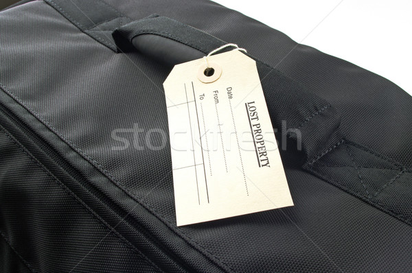 travel bag and lost property tag Stock photo © luapvision