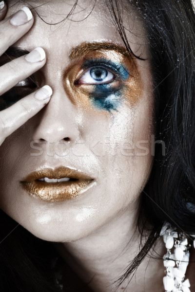 upset crying woman with smudged make-up. Stock photo © lubavnel