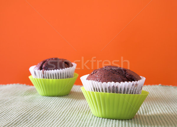 Two muffins in green cups Stock photo © lubavnel