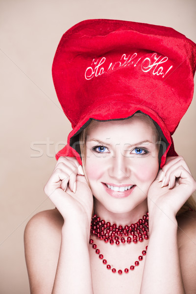 Blond girl in red necklace and hat Stock photo © lubavnel