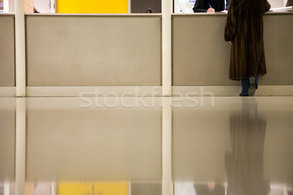 woman at info desk in airport Stock photo © lubavnel