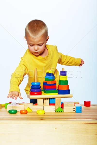 boy playing with pyramid Stock photo © lubavnel