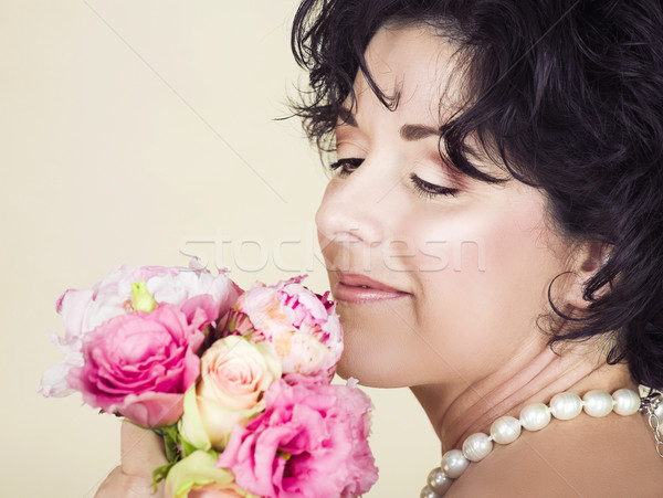 Stock photo: Woman with spring flowers