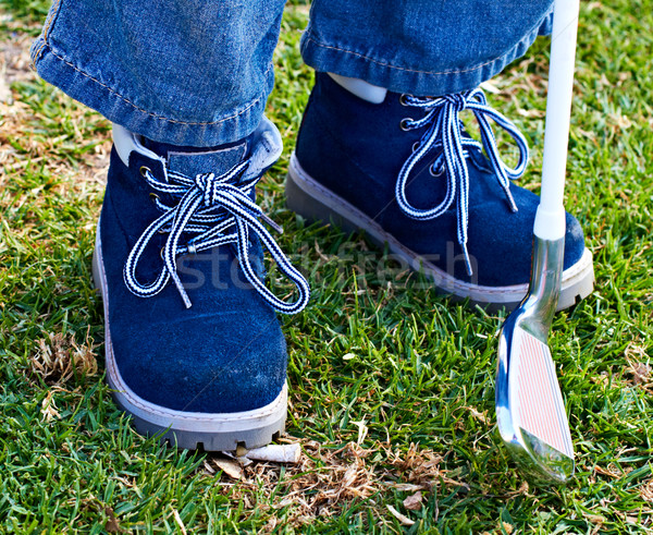 boy shoes and golf club on grass Stock photo © lubavnel