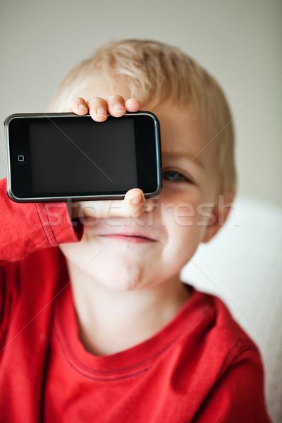 Pequeno menino mídia jogador ano velho Foto stock © lubavnel