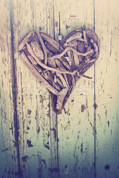 driftwood heart on vintage wall Stock photo © lubavnel